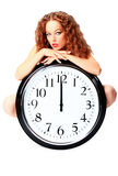 Young woman with a wall clock Stock Images