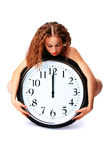 Young woman with a wall clock Stock Image