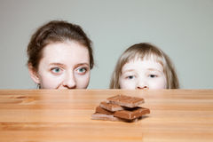 Young woman wanting to eat milk chocolate Stock Photography