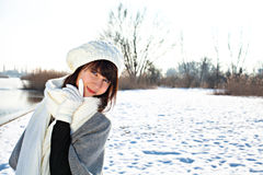 Young woman in warm clothes outdoor in a winter day Royalty Free Stock Images