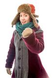 Young woman in warm clothing and celebrating success Stock Images