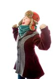 Young woman in warm clothing and celebrating success Stock Image