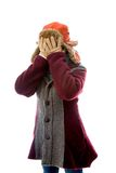 Young woman in warm clothing and covering her face with her hand Royalty Free Stock Photo