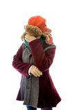 Young woman in warm clothing and covering her face with her hand Royalty Free Stock Photography