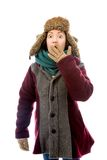 Young woman in warm clothing and looking shocked Royalty Free Stock Photo