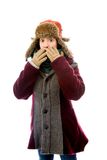 Young woman in warm clothing and looking shocked Stock Image