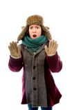 Young woman in warm clothing and making stop gesture sign Royalty Free Stock Photography