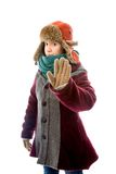 Young woman in warm clothing and making stop gesture sign Royalty Free Stock Photo