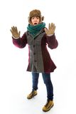 Young woman in warm clothing and making stop gesture sign Stock Images