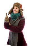 Young woman in warm clothing and pointing upward Royalty Free Stock Photography