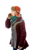 Young woman in warm clothing and shouting with hands cupping mou Stock Photos