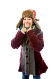 Young woman in warm clothing and showing smiley face Royalty Free Stock Images