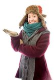 Young woman in warm clothing and showing something Royalty Free Stock Image