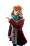 Young woman in warm clothing and showing something Royalty Free Stock Photos