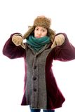 Young woman in warm clothing and showing thumbs down sign with b Royalty Free Stock Image