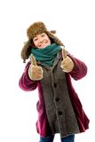 Young woman in warm clothing and showing thumbs up sign with bot Royalty Free Stock Image