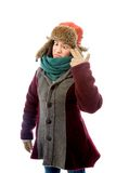Young woman in warm clothing and staring at point of hand gun Royalty Free Stock Image