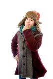 Young woman in warm clothing and thinking Stock Photos