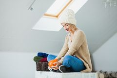 Young woman in warm hand knitted hat at home Royalty Free Stock Images
