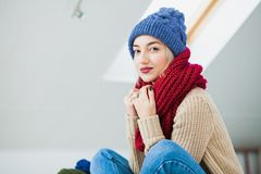 Young woman in warm hand knitted hat at home Royalty Free Stock Photos