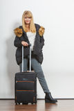 Young woman in warm jacket with suitcase. Stock Photography