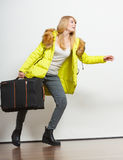 Young woman in warm jacket with suitcase. Royalty Free Stock Photos