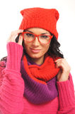A young woman in warm red clothes and glasses Stock Images