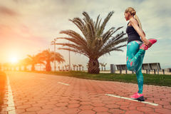Young woman warm up legs before start jogging Stock Photography