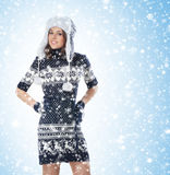 A young woman in warm winter clothes on the snow Royalty Free Stock Photos