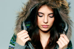 Young woman in warm winter outfit with closed eyes Royalty Free Stock Photo