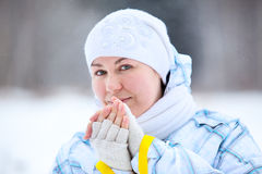Young woman warming fingers Royalty Free Stock Photo