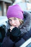Young woman warming fingers Royalty Free Stock Photos