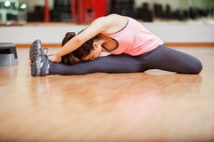 Young woman warming up at a gym Royalty Free Stock Photography