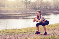 Young woman warming up before a run.a healthy way of life. sports fitness Royalty Free Stock Photos