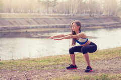 Young woman warming up before a run.a healthy way of life. sports fitness Stock Photos