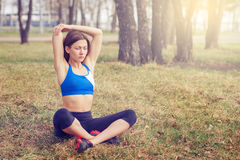 Young woman warming up before a run.a healthy way of life. sports fitness Stock Photography