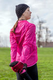 Young woman warming up and stretching before running Stock Photo