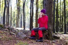 Young woman was allergic to the forest walk. stock photography