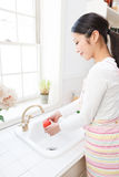 Young woman wash the tomatoes Stock Photography