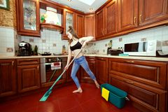 Young woman washes the floors. royalty free stock photography