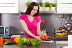 Young Woman Washes The Vegetables Royalty Free Stock Image