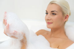 Young woman washing in bathroom Stock Photography