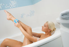 Young woman washing in bathroom Royalty Free Stock Images