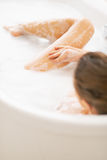 Young woman washing in bathtub. rear view Stock Photos