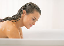 Young woman washing in bathtub Stock Images