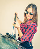 Young woman washing car with brush royalty free stock image
