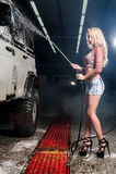 Young woman washing car Stock Photo