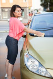 Young woman washing the car smiling Royalty Free Stock Photos