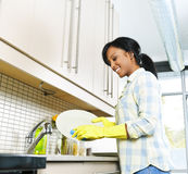 Young woman washing dishes stock images