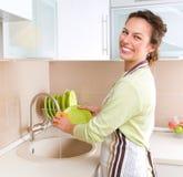 Young Woman Washing Dishes. Dishwashing. Happy Young Woman Washing Dishes Stock Images